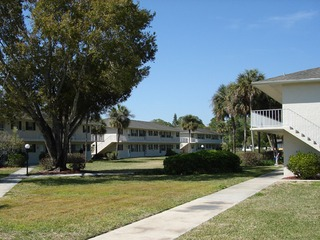 Naples Real Estate - POINCIANA CONDO Main Community Photo